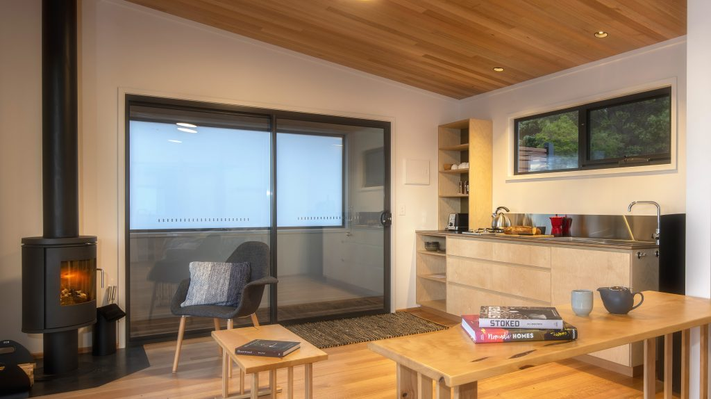 Stylish kitchen and lounge area in the Beach Shacks at Spring Bay Mill.<