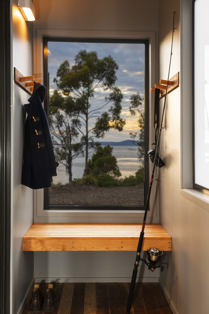Large glass windows looking out to Windlass Bay give guests that cloe to nature feel.<