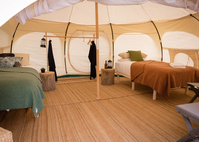 5 meter Lotus Belle tents with single beds.<